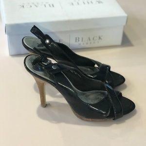 Black sling back open toe heels